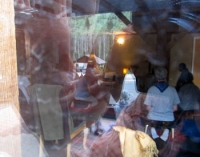 Meditators through window reflections.jpg